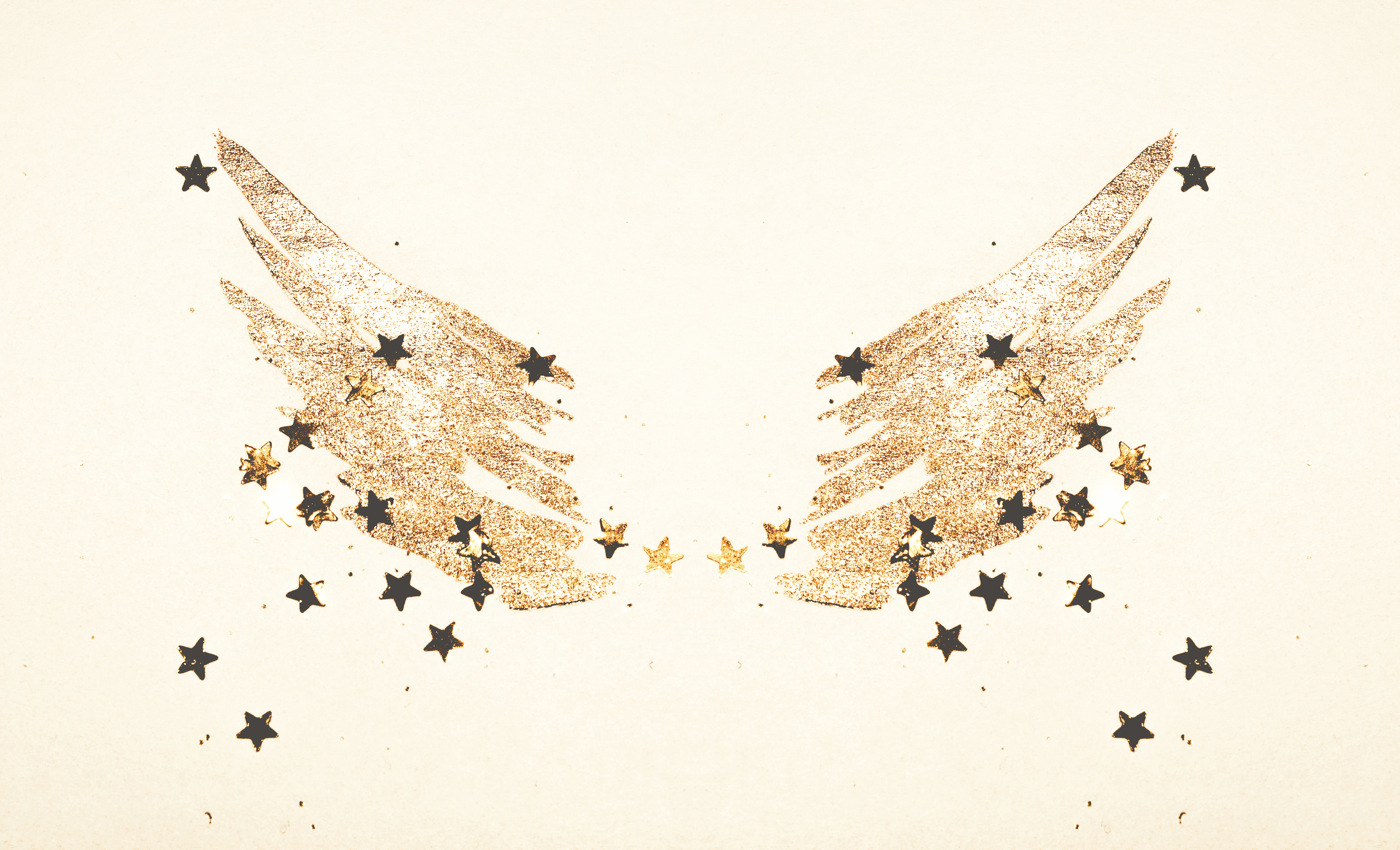 Golden glitter and glittering stars on abstract watercolor wings in vintage colors.